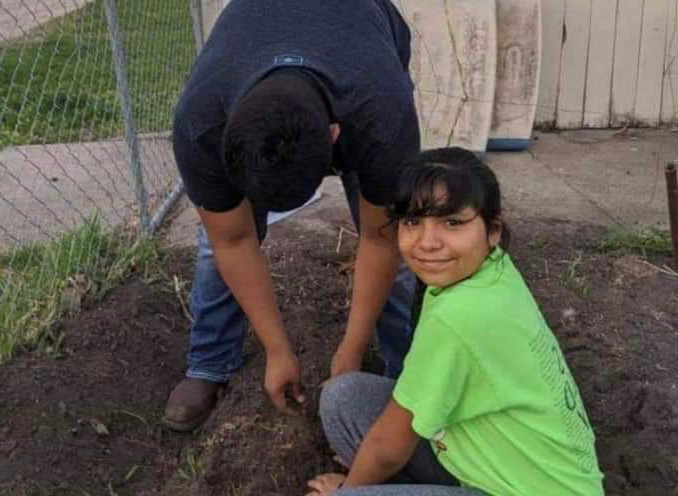 Bryan+and+Yareli+Romero+help+plant+trees+with+the+SCS+Warriors+Academy+program.